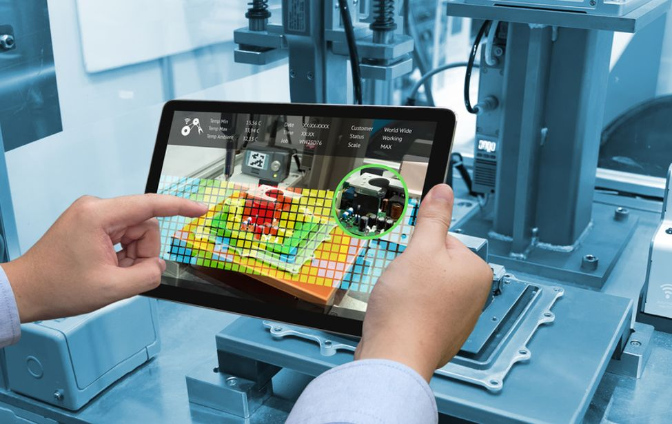 industry 4.0 concept. Man hand holding tablet ©zapp2photo/Fotolia